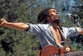 BOB MARLEY (1945-1981) Jamaican reggae musician at the Santa Barbara Bowl in 1976. Photo Jeffrey Mayer
