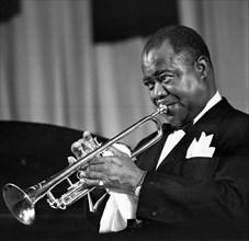 Louis Armstrong, jazz singer, trumpet player, popular, African - American