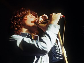 An undated file picture shows 'The Doors' singer Jim Morrison during a concert. Jim Morrison is supposed to be pardoned from the accusal of having denuded in public during a concert, by the parting go...
