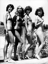 Jan. 01, 1950 - L - File Photo: circa 1940s-1950s, location unknown. Girls posing in bikini's in fashion shows, shoots and on beaches tanning. According to the official version, the modern bikini was ...