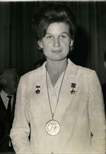 May 13, 1965 - Valentina Terechkova, the first woman astronaut, received the Prix Galabert for her 3-day space flight in 1964. Pictured wearing her medal.