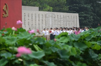 Chinese communists party members take an oath in front of the party flag sign at a Party Memory Mesume as part of celebrations for the July 1 Chinese Communist Party's 94th anniversary in JiaXing, Zhe...