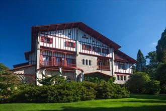 The back of the Arnaga villa (landscaped garden side) built for Edmond Rostand,  at Cambo-les-Bains (France).  .