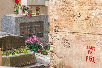 Paris Jim Morrison, view of the grave of rock musician and poet Jim Morrison in the Pere Lachaise Cemetery in Paris, France.