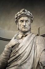 Florence. Italy. Statue of Dante Alighieri (ca. 1265-1321), Italian poet, Uffizi Gallery.