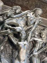 """Paris - Museum Rodin. The Gates of Hell is a monumental sculptural group work by Rodin that depicts a scene from """"The Inferno"""",  Dante Alighieri's Div"""
