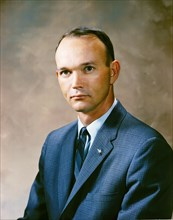 Portrait of astronaut Michael Collins in a business suit.