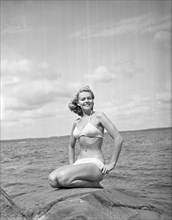 1940s bikinifashion. A swedish young woman in a white bikini on a summer's day. Sweden 1948. Photo Kristoffersson ref 217a-7. Her name is Haide Göransson, swedish fashion model.