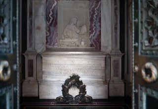 The Tomb of Dante is an Italian neoclassical national monument built over the tomb of the poet Dante Alighieri.