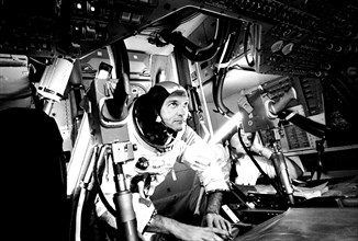 Photograph of the pilot Michael Collins at Apollo 11 Command Module, practicing docking hatch removal from CM simulator at NASA Johnson Space Center, Houston, Texas, June 28, 1969. Image courtesy Nati...