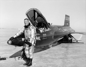 Dryden pilot Neil Armstrong poses next to the X-15 ship 1 rocket-powered aircraft after a research flight, November 30, 1959. Image courtesy National Aeronautics and Space Administration (NASA). ()