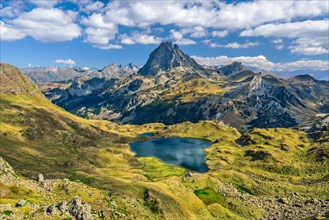 View at Ossau valley from the mountain pass Ayous in Franch Atlantic Pyrenees, as seen in October. Lake Gentau is at foreground of the famous Pyrenean