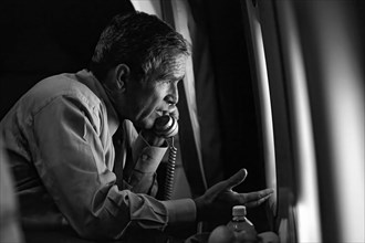 President George W. Bush talks on the phone with Vice President Dick Cheney from Air Force One after departing Offutt Air Force Base in Nebraska for Washington, D.C. on Tuesday, September 11, 2001.