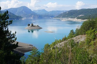 panoramic view of the bay st michel on serre ponçon lake, france