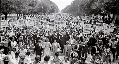 Leaders of the 1963 March on Washington for Jobs and Freedom raise their hands together as they move along Constitution Avenue in Washington, DC on August 28, 1963. Some of the leaders in the march, f...