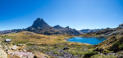 Pic du Midi d'Ossau mountain and Lac Gentau mountain lake in Ossau Valley, iconic symbol of the French Pyrenees, protected area of Pyrenees National P
