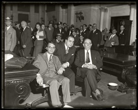 Al Capone sits in federal court during his tax evasion trial with his attorneys Michael Ahern, left, and Albert Fink, right. Chicago, Illinois,  October 7, 1931. Image from 4x5 inch glass negative.