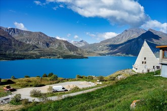 Summer view of the artificial Mont Cenis Lake, in the Savoy department near Lanslevillard, Rhone-Alpes, France near the italian border