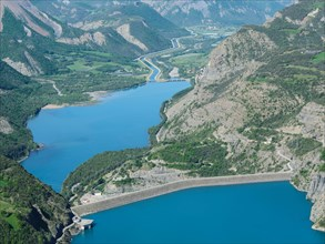 AERIAL VIEW - Dam of Lake Serre-Ponçon with the EDF canal and the Durance River in the distance. France.