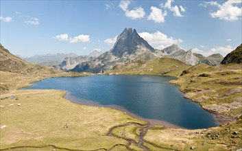 The West side of the Midi d'Ossau Peak and the Gentau Lake, seen from the vantage point of the Ayous refuge (Western Pyrenees).