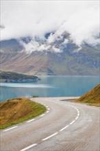 Curving road beside Lac du Mont Cenis, Savoie, France