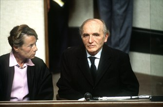 (dpa files) - Klaus Barbie, former German Secret State police (Gestapo) of the city of Lyon, sits with a translator during his trial in a court room in Lyon, France, 11 May 1987. Barbie was accused of...