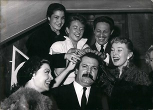 Mar. 03, 1954 - Have a Shampoo?: Georges Brassens, famous 'Realistic' singer being given ''Shampoo'' by three charming singers (from left to right) Arlette Sauvage, Leila Farida, Dick Micheyl, Jean Sa...
