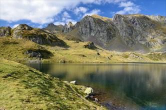 Alpine mountain lake Gentau under the peak Larry