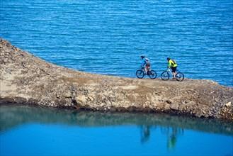 Mountain biking around Alp lake Lac du Mont Cenis, France, Savoie