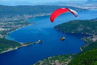 paragliding over the lake Annecy, France, Haute-Savoie