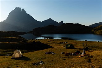 Hiking and tents, around the Ayous lakes, Gentau lake and Pic du Midi d'Ossau, Ayous lakes route, Pyrenees mountains, France, Eu