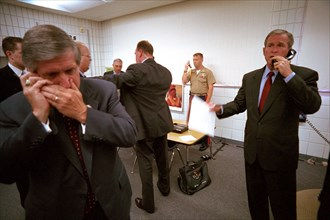 U.S. President George W. Bush and White House Chief of Staff Andy Card make phone calls after hearing news of the September 11 terrorist attacks during a visit to the Emma E. Booker Elementary School ...