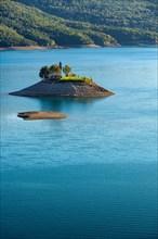 The Saint Michel Chapel and Serre Poncon lake. Saint Michel Bay, Hautes Alpes, Southern French Alps, France