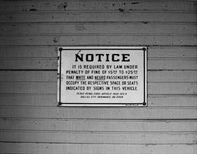 Pre civil rights sign requiring separate seating for Whites and Negroes on old railroad depot historic Buffalo Gap, Texas, USA