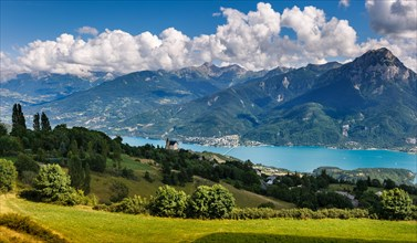 The village of Saint Apollinaire's church with Summer view on Savines-le-Lac, Serre Poncon Lake and Grand Morgon, Alps, France