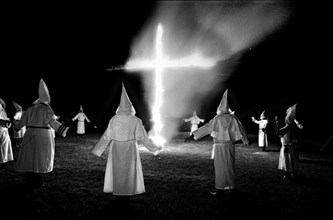 Members of the KKK circle a cross lighting in Rumford Me during rally in the small town Maine town. The Klan had been active in Maine in the 1920's and 30's , This group of Klansmen openly invited the...