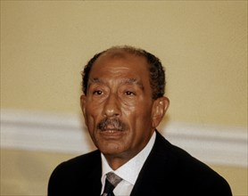 Anwar Sadat the President of Egypt conducts a press conference in the sitting room of the Blair House during his state visit to the White House in Washington DC., August 6, 1981. Photo by Mark Reinst...
