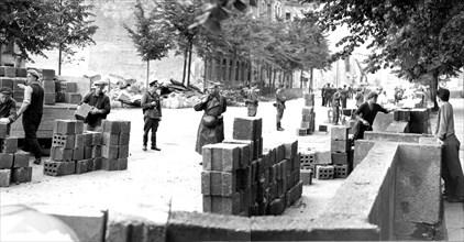 Building the Berlin Wall under armed guard, Berlin, Germany, 1961.