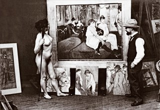 Toulouse-Lautrec and naked model in his studio standing in front of his 1893 painting Au Salon de la rue des Moulins. Henri Marie Raymond Toulouse-Lautrec, aka Henri de Toulouse-Lautrec, 1864-1901. Fr...