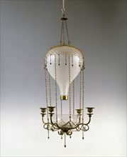 Light fitting with four candle holders in the shape of a hot-air balloon
