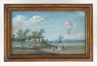 Envol d'une montgolfière dans un paysage animé