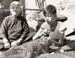Repairing fishing nets in Hong Kong