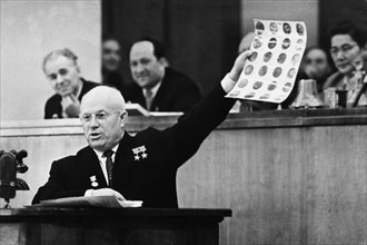 Soviet premier, nikita khrushchev, showing photographs of objects found in the u2 spy plane that was shot down over soviet territory on may 1st, 1960, joint session of council of the union and council...