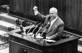 Nikita khrushchev speaking from the rostrum of the 3rd soviet writers' congress, 'long live soviet writers, loyal assistants of our party in the upbuilding of communism!', from the newspaper 'sovetska...