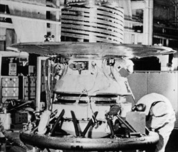 The descent capsule of the soviet space probe venera 9 being worked on in the assembly shop,1975.