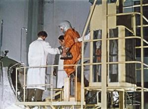 Soviet cosmonaut yuri gagarin boarding vostok 1 rocket in 1961, this is a still from a soviet film about the space program.