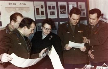 Yuri gagarin and other soviet cosmonauts examining the first pictures of the moon taken by the luna 1 space probe (lunik) in 1961.