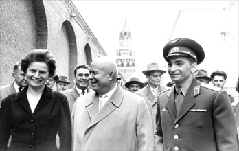 Nikita khrushchev with soviet cosmonauts tereshkova and bykovsky on the grounds of the moscow kremlin after the celebration rally in their honor on june 22, 1963.