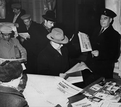People reading the special edition of the newspaper 'evening moscow' with a report of the launch of the soviet union's third rocket into space, october 9, 1959.
