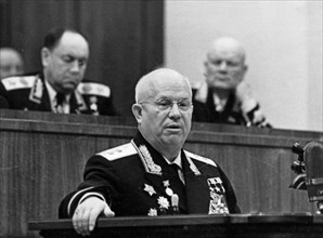 Nikita khrushchev, first secretary of the cpsu central committee and chairman of the ussr council of ministers, speaking at a meeting at the grand kremlin palace in honor of the 20th anniversary of th...